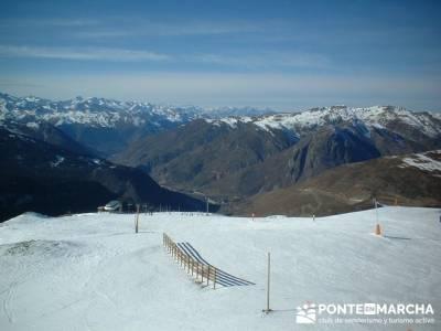 Esquí Baqueira; rutas senderismo guadarrama; ruta bola del mundo